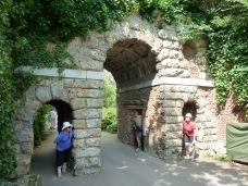 Three amigos pop out of Mock Roman Ruin in Kew Gardens