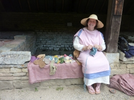 Woman dressed as lady of the Villa and demonstrating weaving