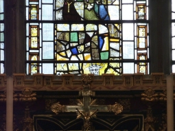 Window in Cirencester Church. See the devil in bottom middle window.