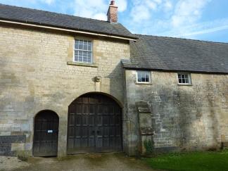 Barn doors hiding Coberley Church