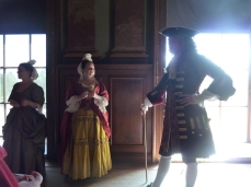 Actors playing George II and Caroline and lady in waiting