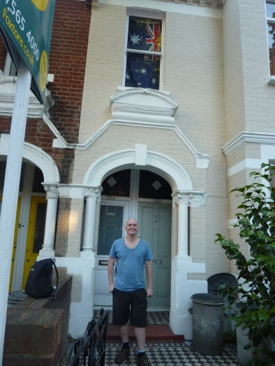 Christopher in front of his house